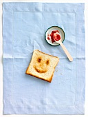 Smiling face grilled on a slice of bread