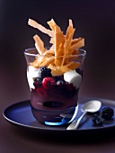Summer fruit in red wine with yoghurt and flaked Gavottes