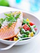 Piece of salmon with broad beans and citrus fruit