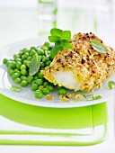 Cod coated in crushed hazelnuts and peas with mint and basil