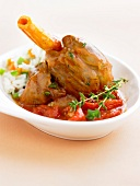 Knuckle of lamb with tomatoes and thyme