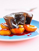 Chocolate fondant with apricots and redcurrant puree