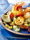 Pan-fried Dublin Bay prawns with artichokes,chorizo,lemon and raisins