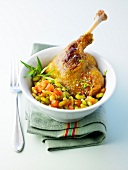 Duck leg with tarragon, flageolet beans cooked with fresh tomatoes