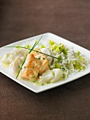 Three varieties of fish in white sauce,basmati rice with leeks