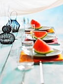 Layed table with watermelon and lanterns