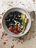 Squid ink tagliatelles with calamaries