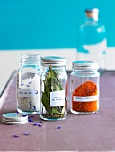 Small jars of spices and dried herbs