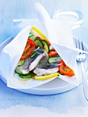 Sea bass and vegetables cooked in wax paper