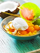 Melon ball and mango fruit salad with coconut ice cream