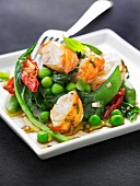 Spiny lobster tail,pea,spinach sun-dried tomato and sugar pea salad