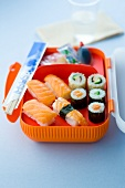Assortment of makis and sushis in a lunch box