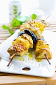 Chicken, prune and pineapple brochettes