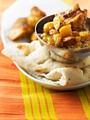 Pork with mango chutney and dried fruit