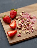 Strawberries and crushed pink pralines