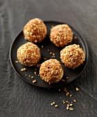 White chocolate truffles coated in crushed peanuts