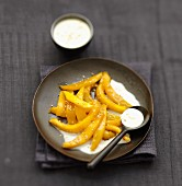 Roasted mango with coconut and sesame cream