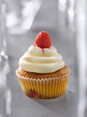Cream cheese and raspberry cupcake