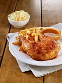 Spicy chicken leg with honey sauce and homemade french fries