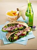 Ham,avocado,tomato and lettuce pitta sandwich