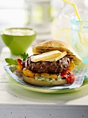 Hamburger with grilled bell peppers, cheese and bearnaise sauce