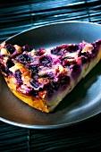 Slice of cherry batter pudding