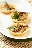 Aubergine caviar and Korean enoki mushroom tartlets