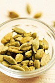 Small bowl of green cardamom