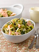 Heart-shaped pasta with salmon,spinach and almonds