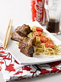 Spare-ribs caramelized in Coca Cola with noodles