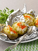 Baked potatoes with cream and salmon roe