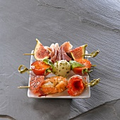 Assortment of brochettes and antipasti