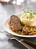Fillet of stag in dark chocolate, mushroom and honey sauce, white rice