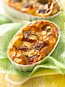 Plum and thinly sliced almond batter pudding