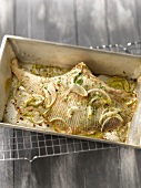 Oven-baked skate with onions and herbs