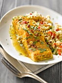 Salmon in mild spicy sauce and quinoa