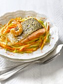 Saffron-flavored piece of salmon with shrimps and thinly sliced vegetables