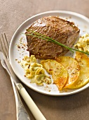 Ostrich steak with apples and ginger