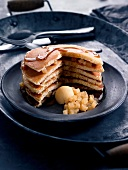 Layered pancake and pear cake with maple syrup