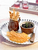 Homemade tapenade with cheese tuiles and bread sticks