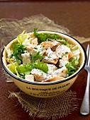 lettuce salad with chicken, tofu, yoghurt sauce and oregano