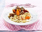 Beef and pumpkin stew with tagliatelles