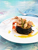 Squid ink spaghettis with samfaina and seafood