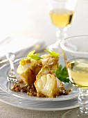 Curried monkfish with saffron walnuts