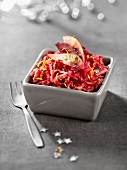 Grated raw apple and beetroot salad in aniseed-flavored orange juice