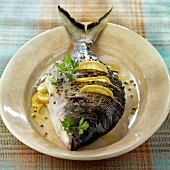 Oven-baked sea bream with lemon and coriander seeds
