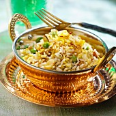 Biryani rice with cardamom, saffron, raisins, peas and almonds