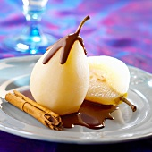 Poached pears with cinnamon-flavored melted chocolate