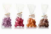 Four bags of different flavored meringues