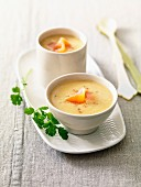 Cream of orange lentil soup with flaked salmon